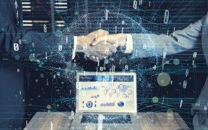 uścisk dłoni na cyfrowym tle